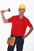 Construction worker with a mallet — Stock Photo