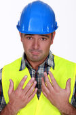 Construction worker holding his hands up — Stock Photo
