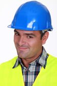 Close-up shot of a smiling tradesman — Stock Photo