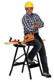 Relaxed carpenter next to a workbench — Stock Photo