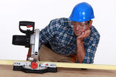 Man with a circular saw — Stock Photo