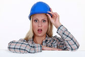 Craftswoman looking very surprised — Stock Photo
