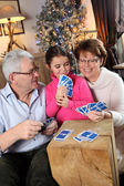 Family playing card game at Christmas — Foto Stock