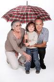 Stay under the umbrella honey — Stock Photo