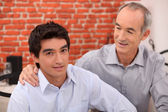 Man supporting his grandson — Stock Photo