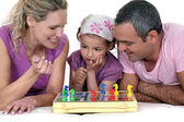 Family playing chess — Stock Photo