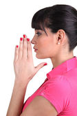 Brunette praying — Stock Photo