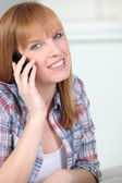 Red-haired woman with mobile phone — Stock Photo