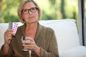 Woman about to take her medication — Stock Photo