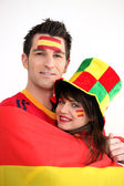 Couple supporting the Spanish football team — Stock Photo