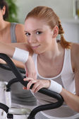 Redhead girl in gym — Stock Photo