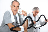 65 years old woman and man doing cardio training — Stock Photo