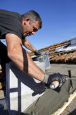 Roofer spreading cement — Stock Photo