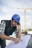 Foreman checking plan — Stock Photo