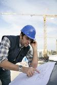 Foreman checking plan — Stock Photo