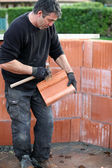 Housebuilder at work — Stock Photo
