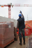 Foreman waving signal to crane operator — Photo