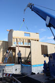 Wooden house frame being built — Stock Photo
