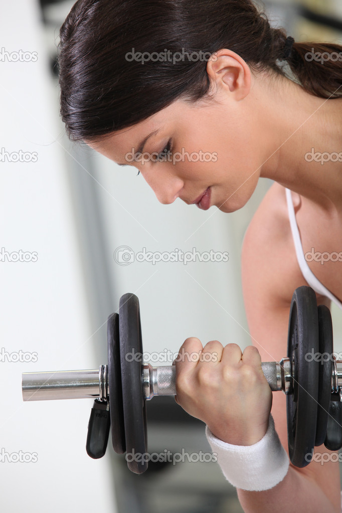 Woman lifting weights — Stock Photo #10197022