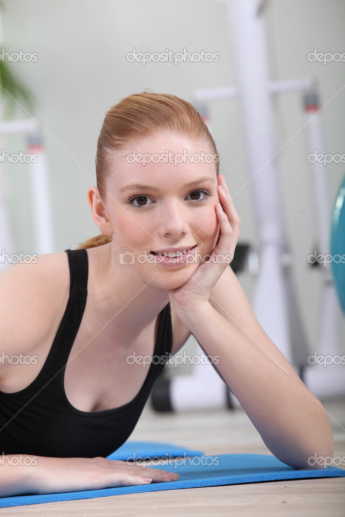 Red-haired girl in the gym  Stock Photo #10197029