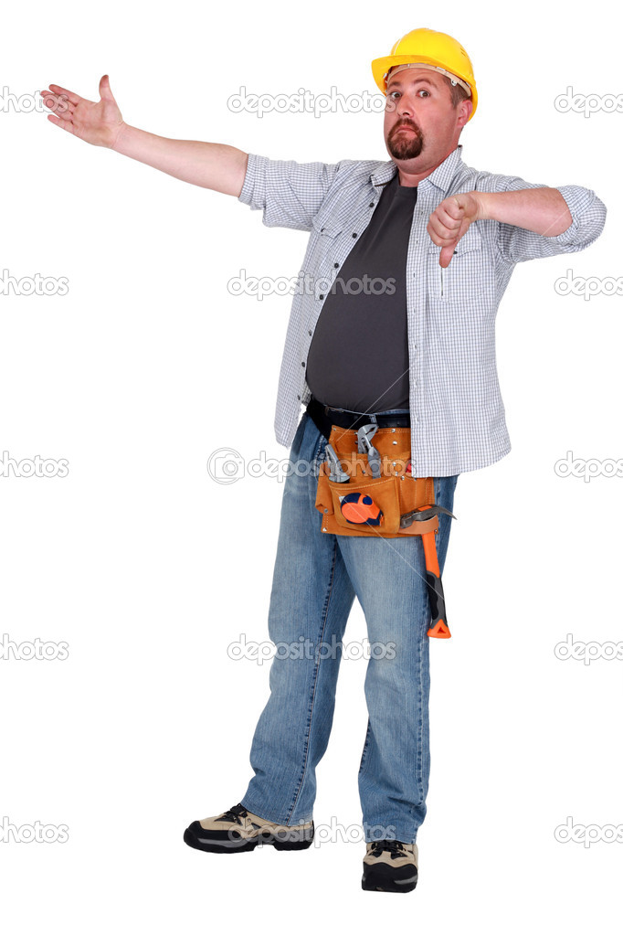 Tradesman pointing to an object and giving the thumb's down — Stock Photo #10197430