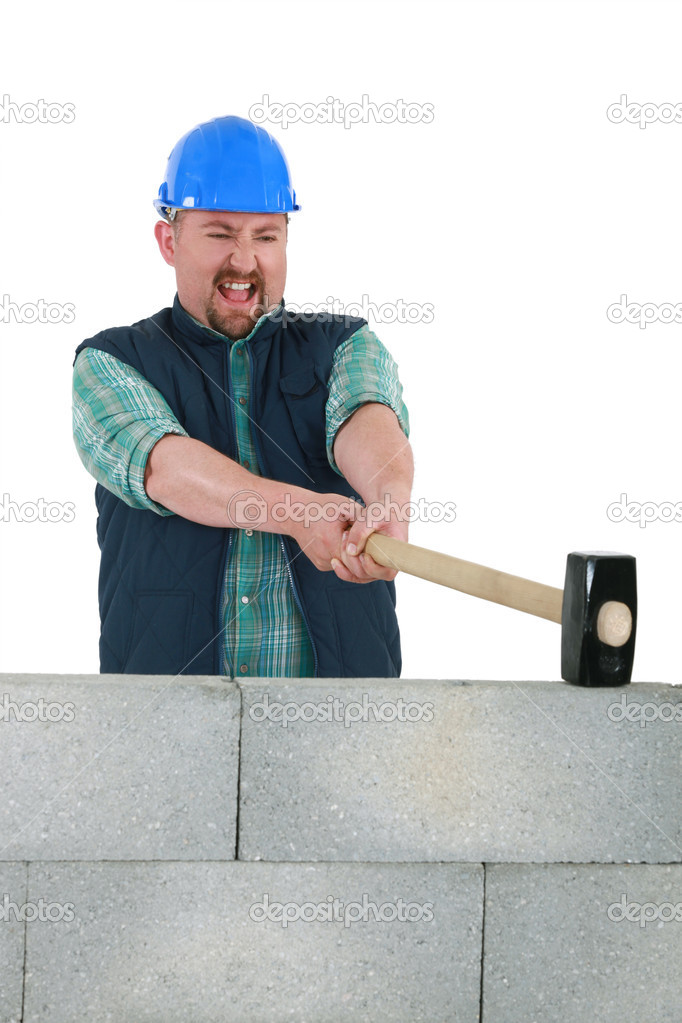 Man destroying wall with sledge-hammer  Stock Photo #10197541