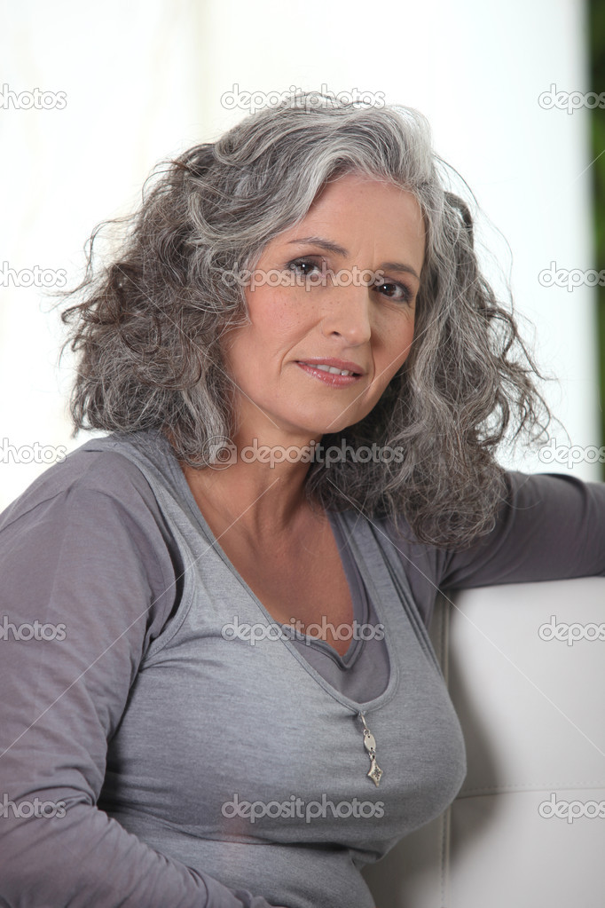 Grey Haired Retired Woman Has A Lot Of Free Time Stock