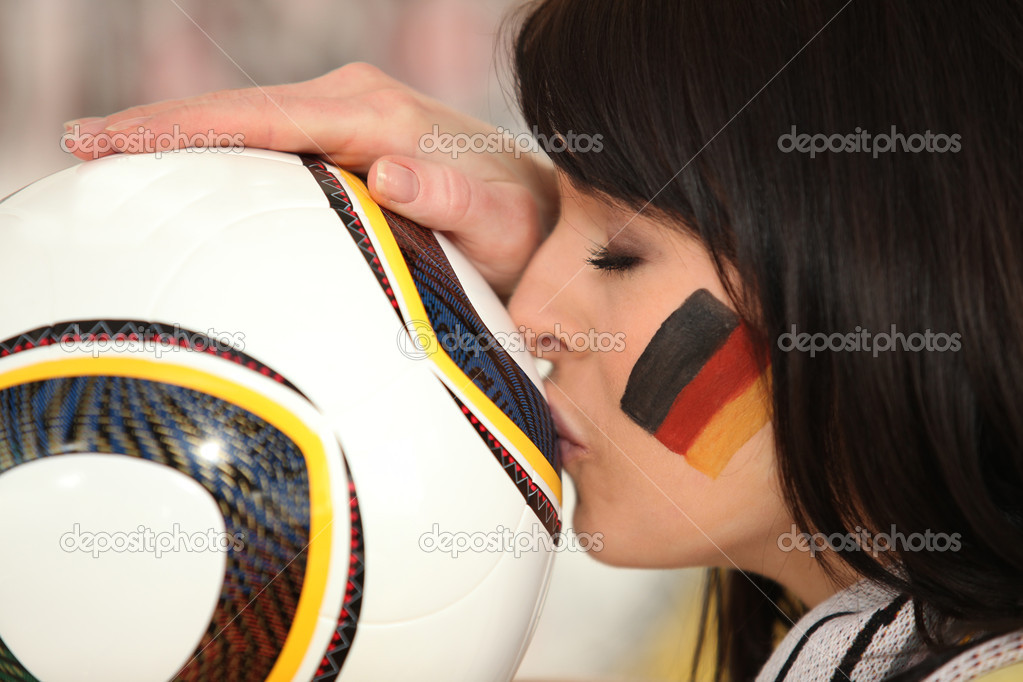 Young german brunette kissing soccer ball — Stock Photo #10198798