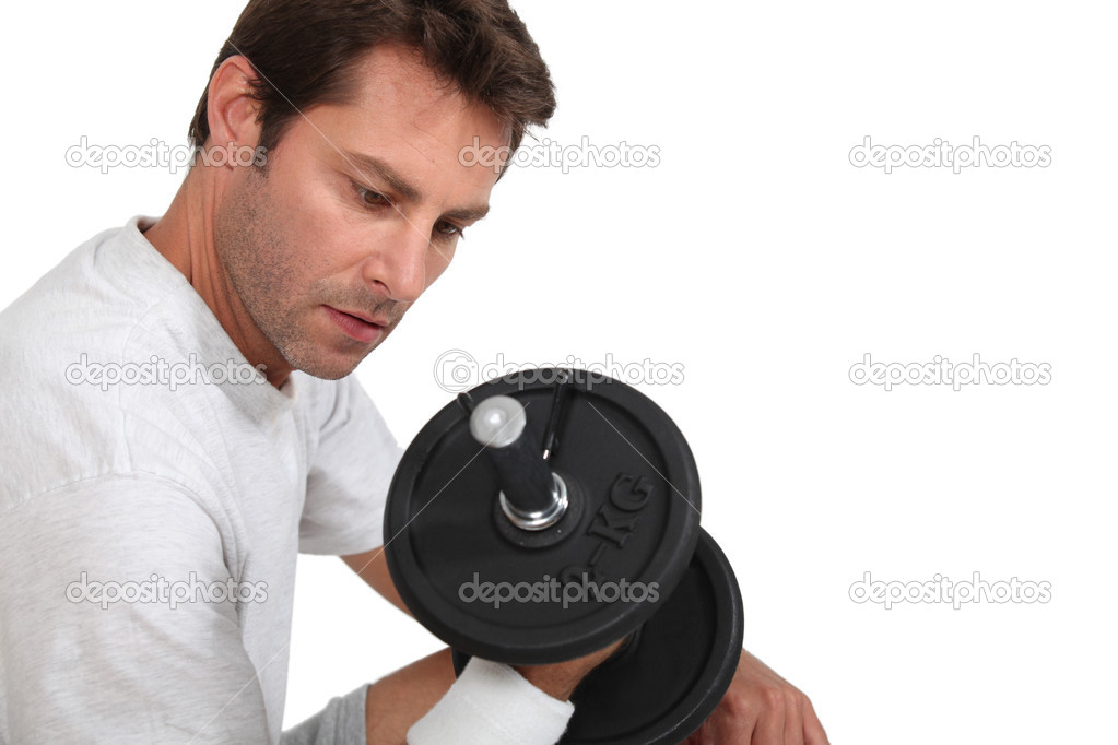 Man working out with dumbbell — Stock Photo #10199050