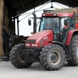 Tractor in a farm - Stock Photo