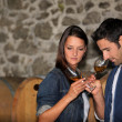 Winegrowers in warehouse — Stock Photo