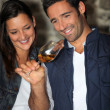 Stock Photo: A couple tasting wine