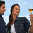 Woman with drink next to man — Stock Photo #10278389