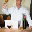 Winemaker analyzing wine - Stock Photo