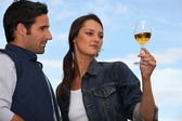 Woman with drink next to man — Stock Photo