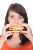 Surprise in front of a hamburger — Stock Photo