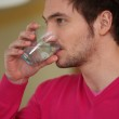 Man drinking glass of water — Stock Photo
