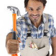 Worker ready to hammer - Stock Photo