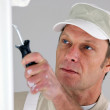 Painter redecorating house — Stock Photo