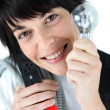 Stock Photo: Electriciholding replacement light bulb