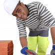 Stock Photo: Bricklayer with pencil and ruler