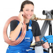 Female plumber and equipment — Stock Photo