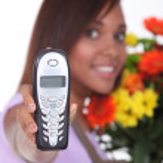 Florist having phone call — Stock Photo