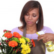 Stock Photo: Florist spraying a bunch of flowers with water