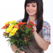 Stock Photo: Florist preparing bouquet