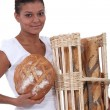 Baker showing off her bread — Stock Photo