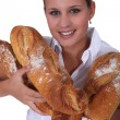 Baker with loaves of bread — Stock Photo #10285341