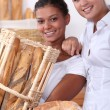 Two young women working in a bakery — Stock Photo #10285481