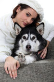 Portrait of a young woman with husky — Stock Photo