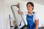 Woman redecorating her house — Stock Photo